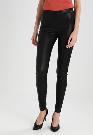 YASZEBA  - Leather trousers - black
