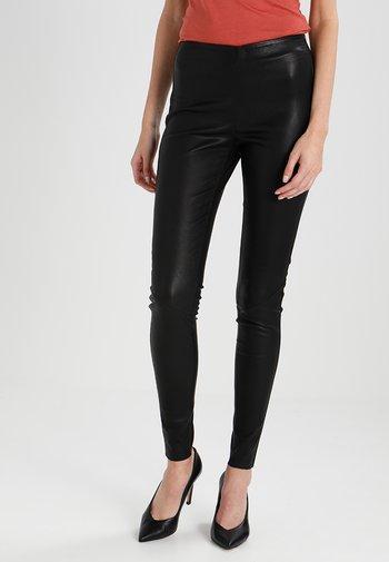 YASZEBA  - Leather trousers - black