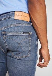 Calvin Klein Jeans - SLIM TAPER - Slim fit jeans - dark blue - 3