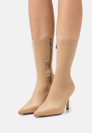 MARINDA - Classic ankle boots - nude