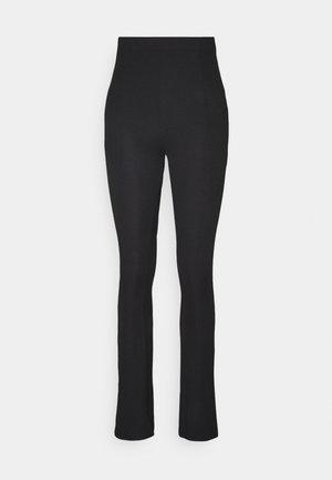 RIB SLIT PANTS - Leggings - black