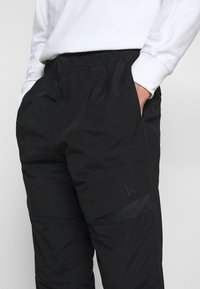 Calvin Klein Jeans - TRACK PANT - Trousers - black - 4