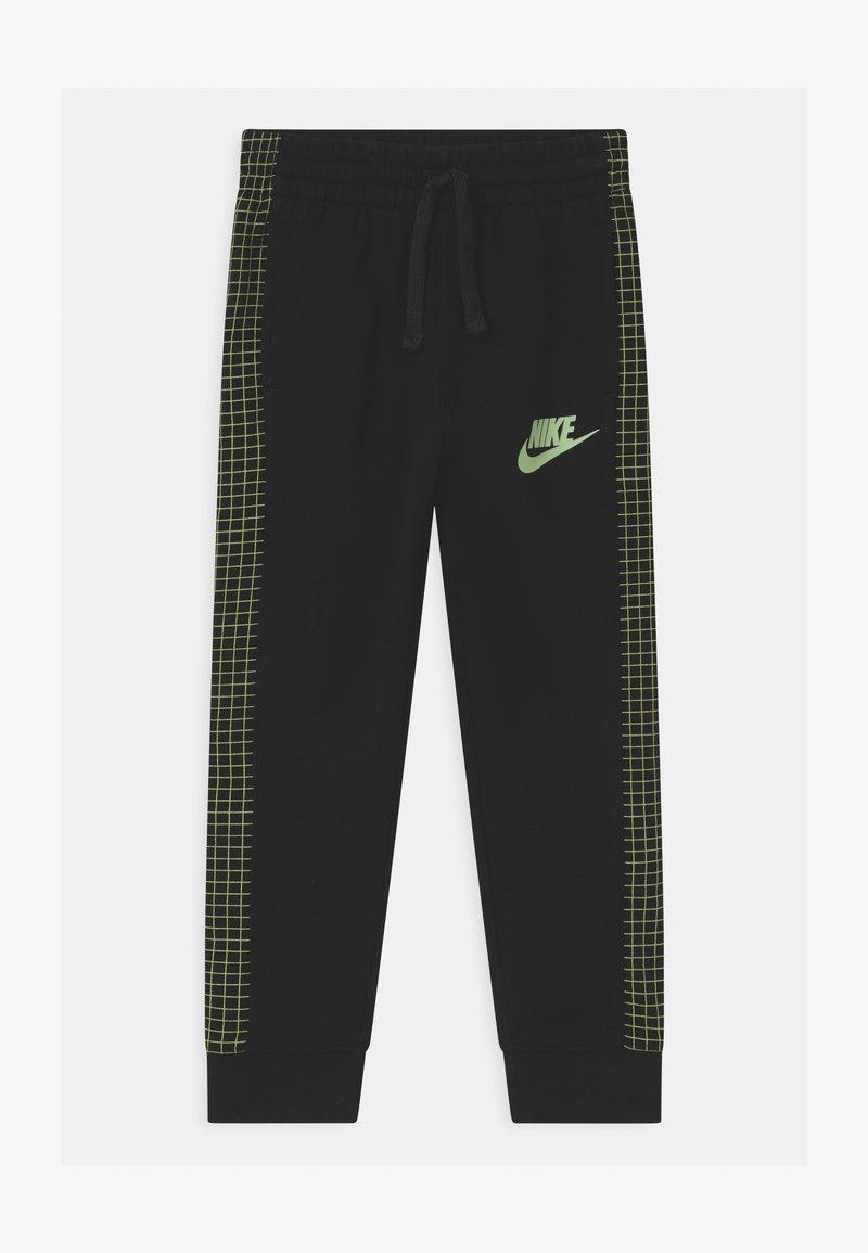 Nike Sportswear - GLOW IN THE DARK UNISEX - Tracksuit bottoms - black