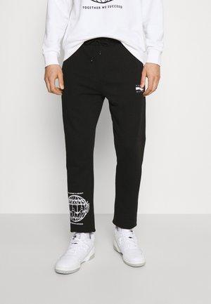 ONE PLANET UNISEX - Pantaloni sportivi - black