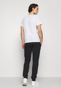 Jack & Jones - JORSCRIPTT PANTS  - Verryttelyhousut - black - 2