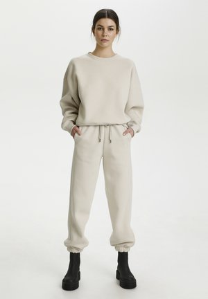 RUBI - Tracksuit bottoms - moonbeam