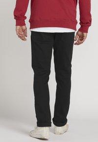Volcom - VORTA - Straight leg jeans - black - 1