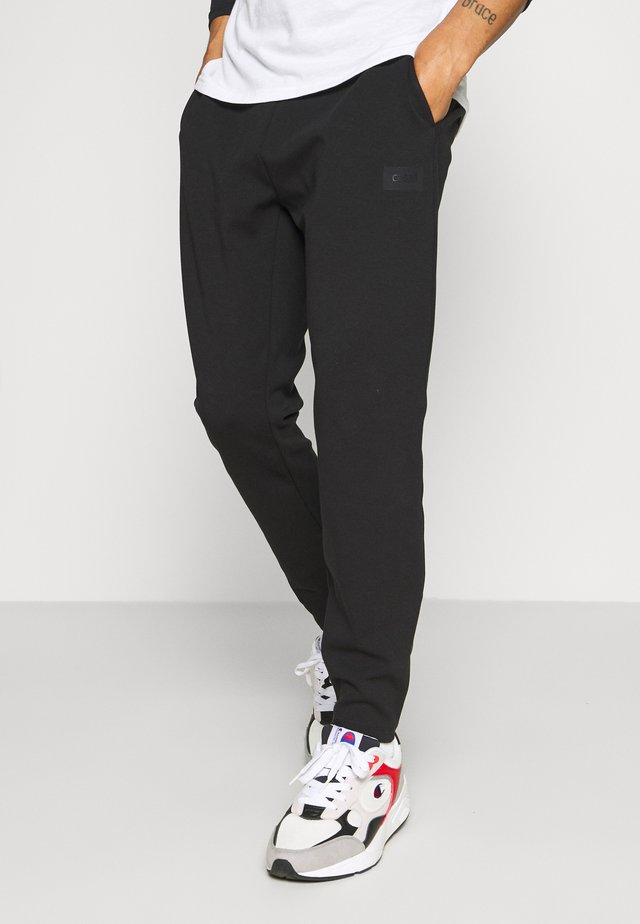 DOUBLE PANTS - Pantaloni sportivi - black