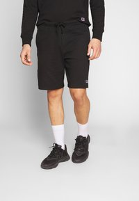 Russell Athletic Eagle R - FORESTER - Tracksuit bottoms - black - 0