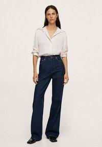 Mango - IDEALE - Button-down blouse - ecru - 1