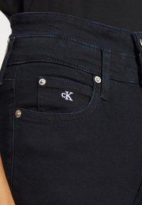 Calvin Klein Jeans - HIGH RISE SKINNY ANKLE - Jeans Skinny Fit - dark-blue denim - 5