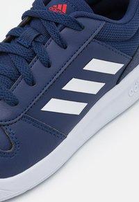 adidas Performance - TENSAUR UNISEX - Sports shoes - dark blue/footwear white/active red - 5