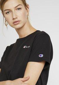 Champion Reverse Weave - SMAL SCRIPT CREWNECK  - Print T-shirt - black - 4