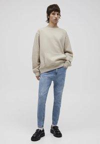PULL&BEAR - Jeans Tapered Fit - mottled dark blue - 1