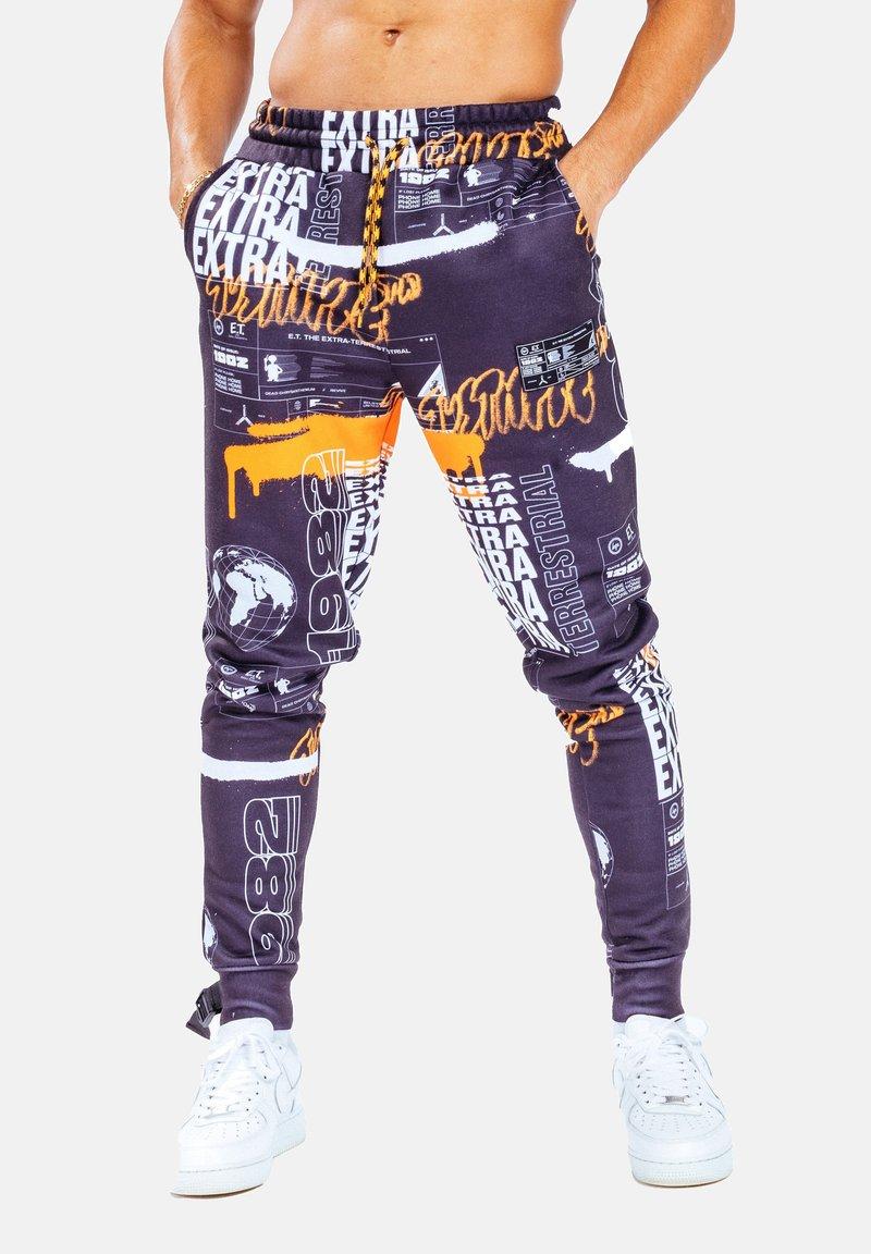 Hype - Tracksuit bottoms - orange/black