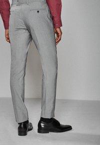 Next - STRETCH TONIC SUIT: TROUSERS-SLIM FIT - Pantaloni eleganti - light grey - 1
