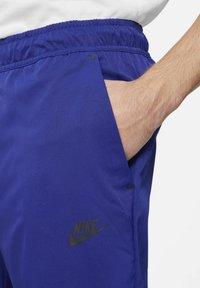 Nike Sportswear - Tracksuit bottoms - deep royal blue/black - 3