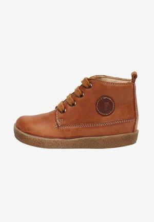 CELIO - Baby shoes - beige