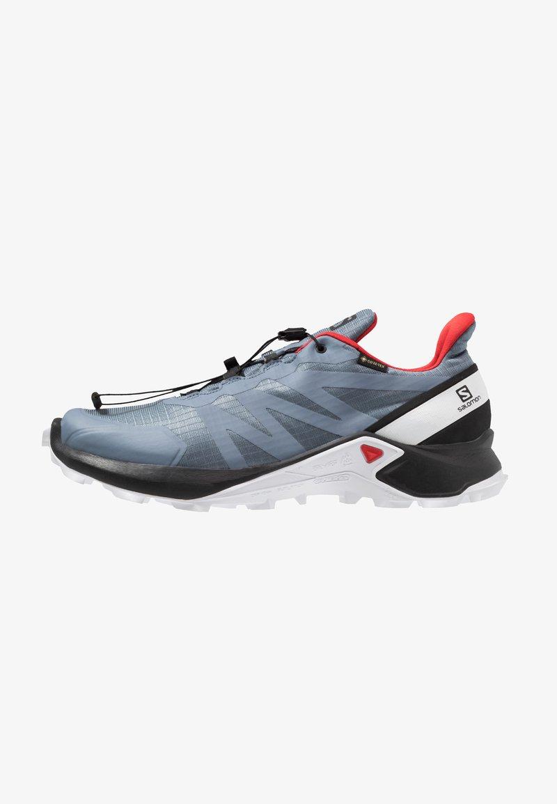Salomon - SUPERCROSS GTX - Trail running shoes - flint stone/black/high risk red
