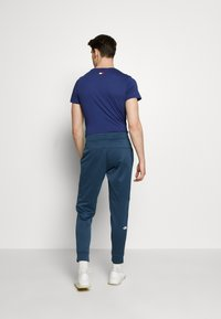 The North Face - MENS SURGENT CUFFED PANT - Teplákové kalhoty - blue wing teal heather - 2