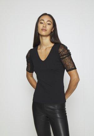 DAIME - Print T-shirt - noir