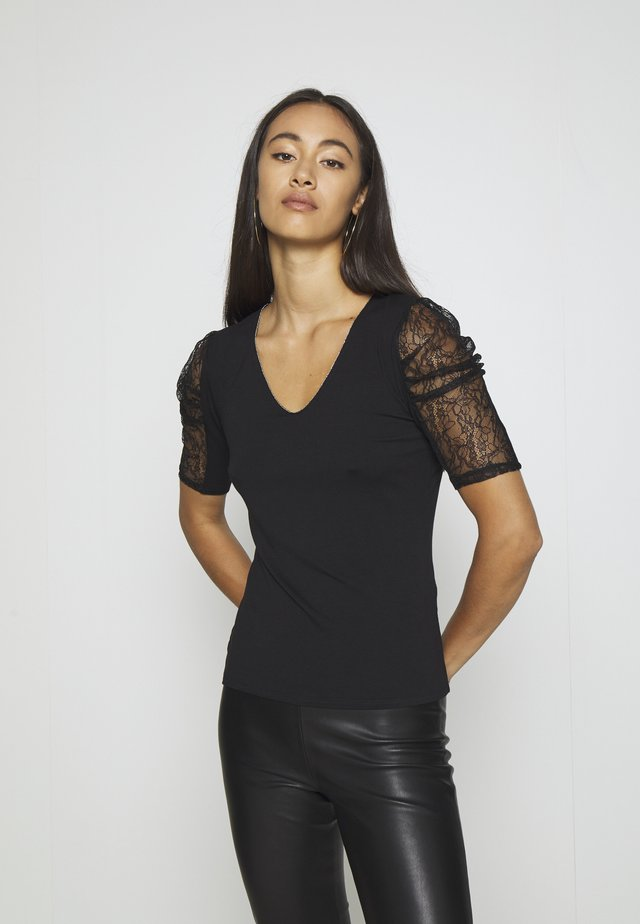 DAIME - T-shirt med print - noir