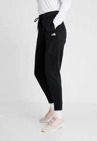 The North Face - SURGENT CUFFEDPANT - Tracksuit bottoms - black - 0
