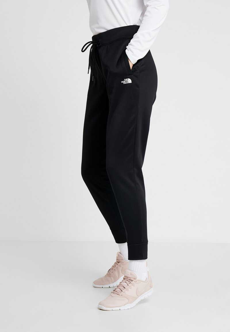 The North Face - SURGENT CUFFEDPANT - Tracksuit bottoms - black