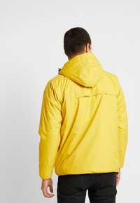 K-Way - UNISEX CLAUDE ORESETTO - Light jacket - yellow mustard - 2