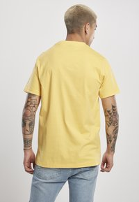 Starter - Print T-shirt - buff yellow - 1