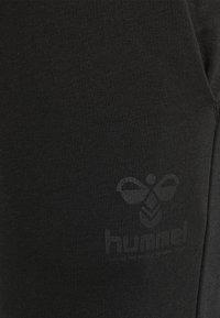 Hummel - Tracksuit bottoms - black - 4