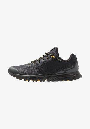 REEBOK SAWCUT 7.0 GTX - Trail running shoes - black/grey/yellow