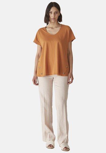 FLUIDO IN PURO - Trousers - beige