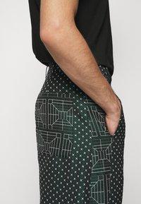 Henrik Vibskov - KEY PANTSMIX DRAIN MIXER - Trousers - dark green - 3