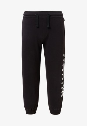 K MOLI - Tracksuit bottoms - black