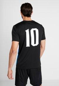 Puma - T-shirt med print - puma black/poppy red - 2