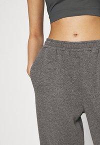 NA-KD - NA-KD X ZALANDO EXCLUSIVE - LOOSE FIT PANTS - Tracksuit bottoms - dark grey - 3