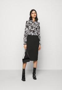 HUGO - ELIFIA - Button-down blouse - black - 1