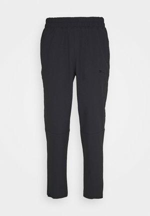 TRAIN VENT PANT - Teplákové kalhoty - black