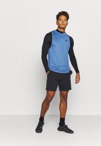 Nike Performance - FLEX - Sports shorts - black/iron grey - 1
