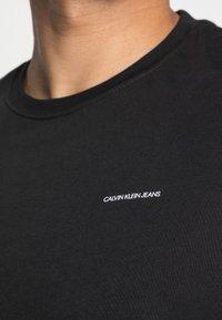 Calvin Klein Jeans - SLIM 2 PACK - T-shirt - bas - bright white/black beauty - 5