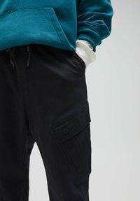 PULL&BEAR - Tracksuit bottoms - black - 4