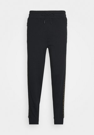 DOKUMI  - Tracksuit bottoms - black/gold