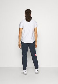 Ellesse - CENNO TRACK PANT - Trousers - navy - 2