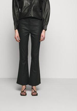 MAUSER - Spodnie skórzane - black