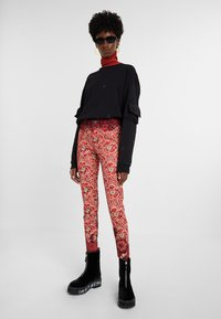 Desigual - DESIGNED BY M. CHRISTIAN LACROIX - Pantalones - red - 1