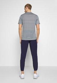 Nike Performance - ESSENTIAL PANT - Verryttelyhousut - imperial purple/reflective silver - 2