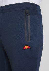 Ellesse - CALDWELO PANT - Teplákové kalhoty - navy - 4