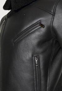 Tommy Hilfiger - BIKER JACKET - Leather jacket - black - 6