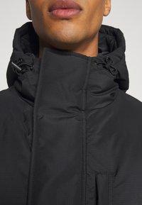 Weekday - JAY PUFFER JACKET - Zimní kabát - black - 9